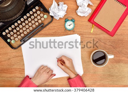 Author hands make notes in a blank page, View from above - stock photo
