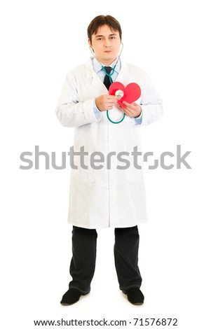 Authoritative medical doctor holding stethoscope on paper heart isolated on white