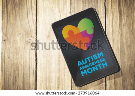 autism awareness month against overhead of tablet on desk - stock photo