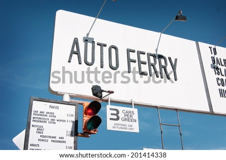 auto ferry sign with traffic light