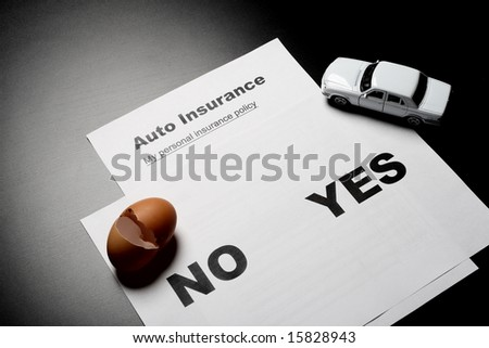 Auto insurance decision and broken egg - stock photo