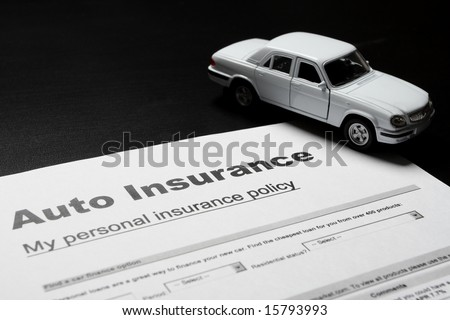 Auto insurance documents and mini car model - stock photo