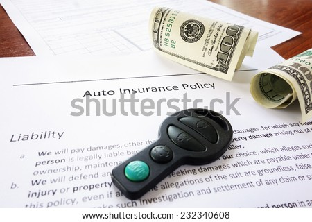 Auto insurance policy with cash and key fob                                - stock photo