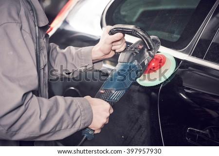 auto mechanic buffing car autobody  - stock photo