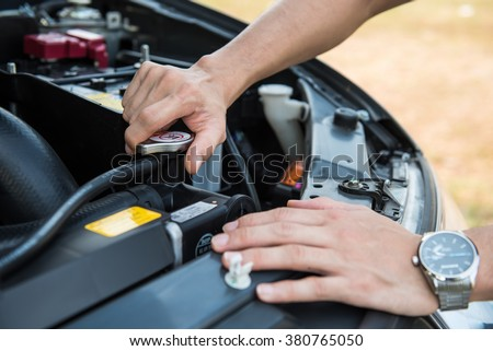 Auto mechanic checking car engine,worker