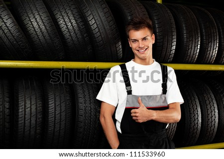 Auto mechanic recommend tire to choose for car - stock photo