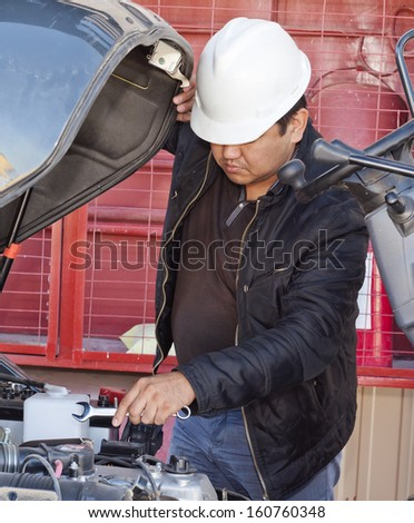 auto mechanic repairing a car engine.