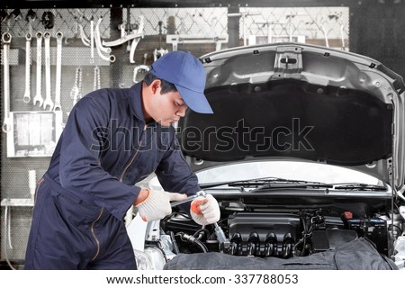 Auto mechanic use tool operation repaired engine at maintenance repair service station with tools background