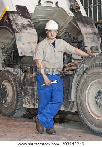 Auto mechanic with wrench. Truck repair service. - stock photo