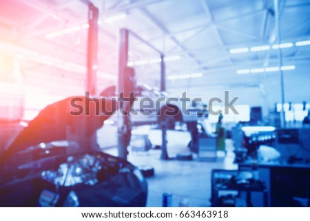 Auto repair service. Blurred background.