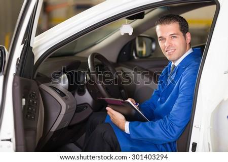Auto repair shop manager posing at camera. - stock photo