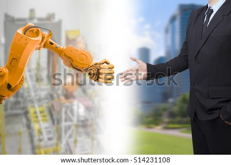 Auto robot in industrial section and human in business with handshake cyber communication high tech concept