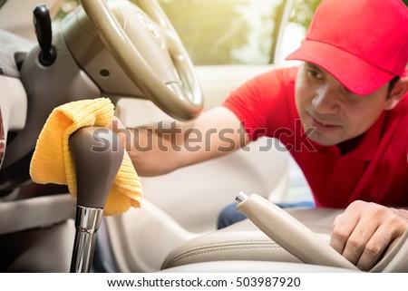 Hand cleaning interior car door panel stock photo 336869813 shutterstock for Interior car cleaning services