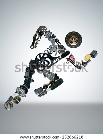 Auto spare parts are laid out in the form of a running man. Spare parts for shop, aftermarket. Spare parts like man. New spare parts for shop. Many auto spare parts for car. Isolated auto spare parts. - stock photo