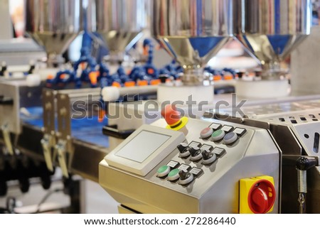 Automated bread production line in bakery - stock photo