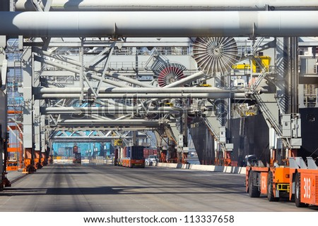 Automated container terminal in a large shipping port. - stock photo