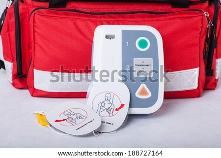 Automated External Defibrillator and rescue bag, horizontal - stock photo