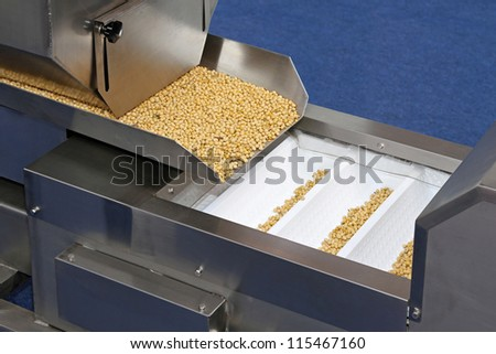 Automated grains food packaging machine production line - stock photo