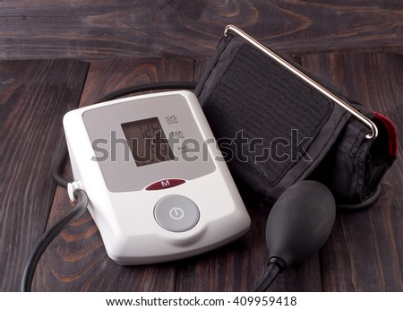 automatic blood pressure monitor on a wooden background