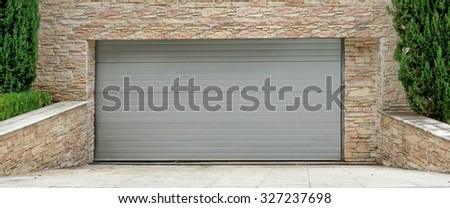Automatic Electric Roll-up Commercial Garage Gate Or Push-up Door In The Modern Building Ground Floor - stock photo