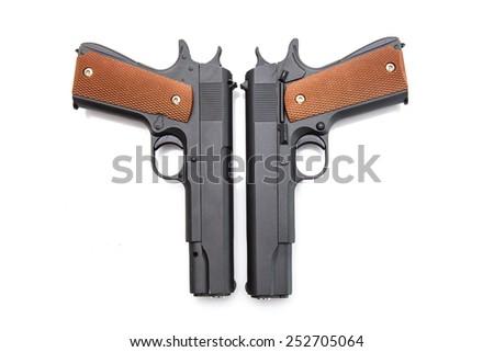 Automatic gun battle on a white background - stock photo