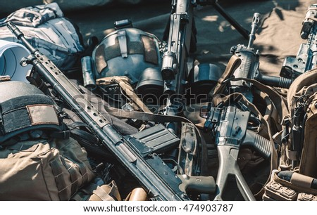 automatic machine, machine gun, helmet, body armor piled in a heap lie on the ground.