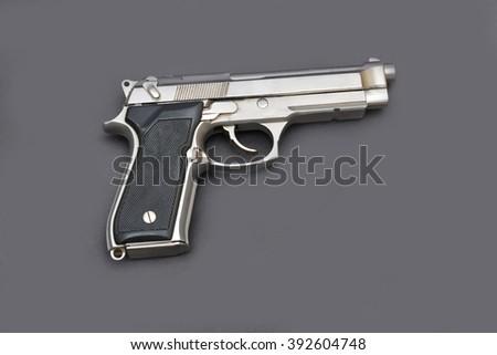 Automatic Pistol gun isolated on gray background - stock photo
