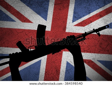 Automatic rifle in hand on background of the British flag
