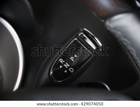 Automatic transmission  selector  under the steering wheel in modern car interior