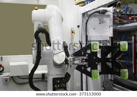 Automatic unloading of the mold of injection molding machine - stock photo