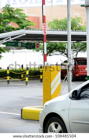 Automatic vehicle Security Barriers with security camera - stock photo