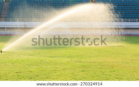 automatic watering system on green grass - stock photo