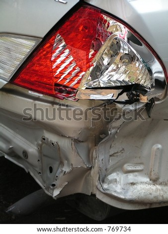 AUTOMOBILE ACCIDENT, SMASHED REAR PASSENGER SIDE - stock photo