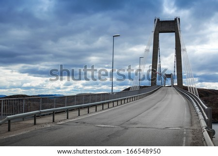 Automobile cable-stayed bridge with asphalt road - stock photo
