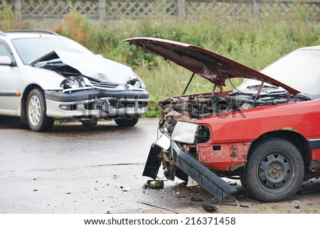 automobile car crash collision accident on an city road - stock photo
