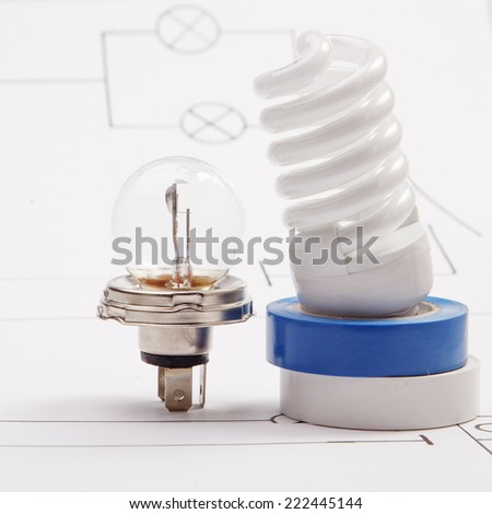 Automobile lamp on a background of the electric scheme - stock photo