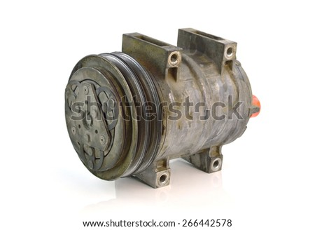 Automotive air conditioning compressor old on a white background. - stock photo