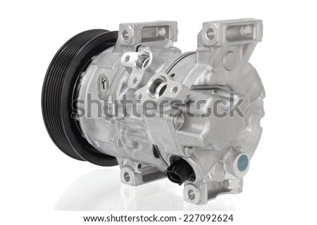 automotive air conditioning compressor on a white background car parts - stock photo