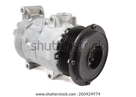 automotive air conditioning compressor on a white background. car parts - stock photo