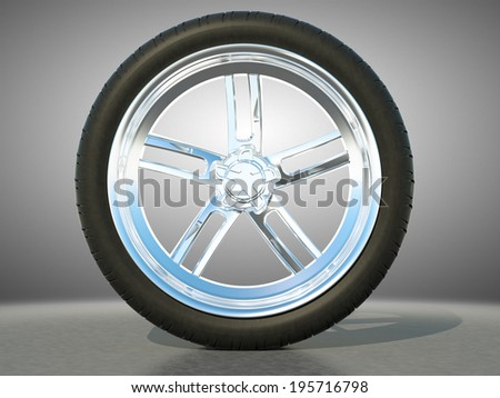 Automotive alloy wheel with tire and studio light background - stock photo