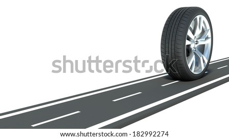 Automotive concept. Wheel on the road - stock photo
