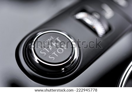 Automotive detail Start Stop button in a luxury car  - stock photo