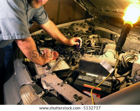 Automotive technician doing repair job.