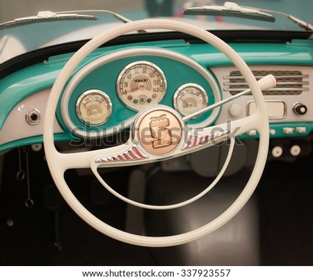AUTOSHOW PRAHA, CZECH REPUBLIC - OCTOBER 4, 2015: Škoda 450 - ancestor of Felicia - renovated vintage car interior design, creamy white steering wheel with old Skoda logo and turquoise blue dashboard