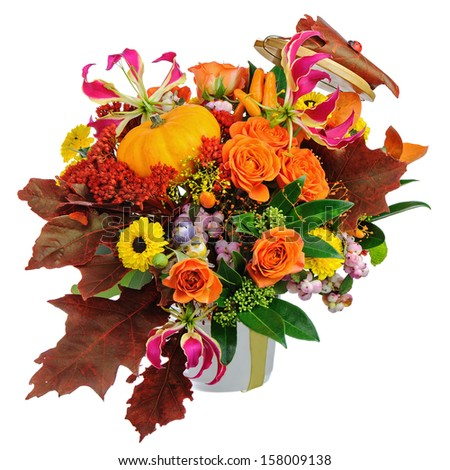 Autumn arrangement of flowers, vegetables and fruits isolated on white background. Closeup. - stock photo