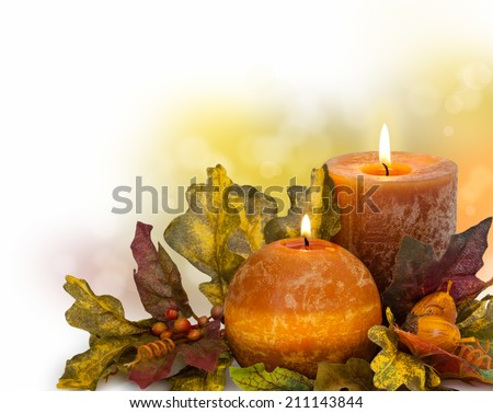 Autumn arrangement with candle against de-focused holiday lights . - stock photo