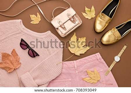 Autumn Arrives. Fashion Lady Clothes Set. Trendy Cozy Knit Jumper. Fashion Stylish Gold Handbag Clutch, Glamour Shoes, Sunglasses. Fall Leaves. Vanilla Pastel colors.
