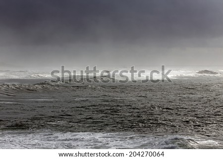 Autumn Atlantic waves approaching the Portuguese coast in a foggy day - stock photo