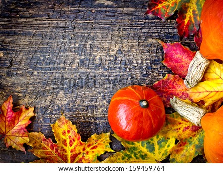 Autumn background/Autumn leaves and pumpkins over wooden background/Thanksgi ving day concept - stock photo