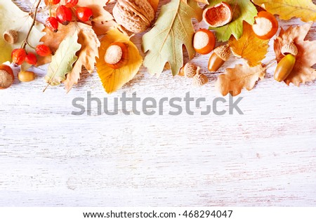 autumn background, autumn nuts and leaves on a table